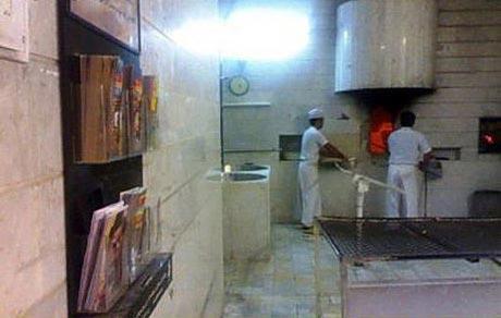 عکس ابتکار فرهنگی جالب یک نانوایی در تهران