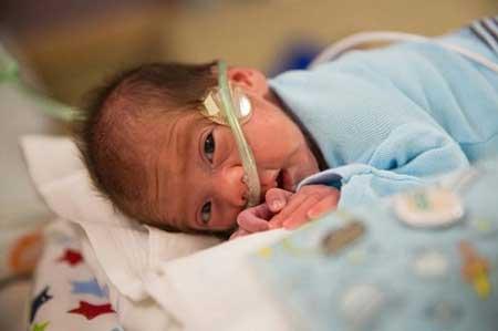 نوزادی که 2 ماه پس از مرگ مادرش به دنیا آمد + عکس