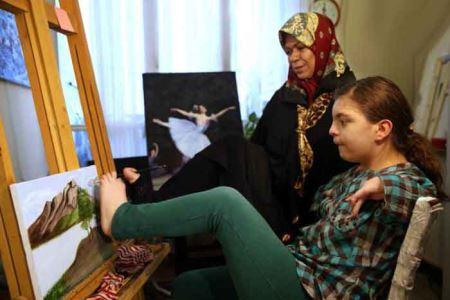 زندگی جالب این زن بدون دست + تصاویر