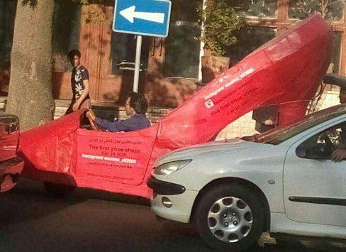 این کفش غول پیکر یک ماشین در تهران است + تصاویر
