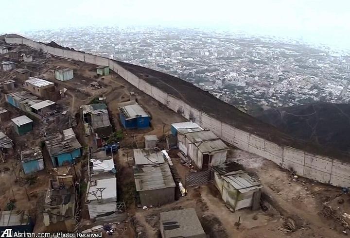 تصاویر دیدنی از دیوار جداکننده فقر از ثروت
