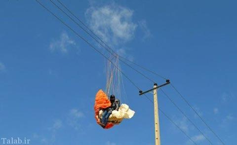 برخورد دختر پاراگلایدر سوار با خطوط برق