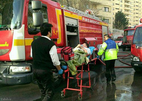 سقوط زن مشهدی در جریان آتش سوزی + عکس